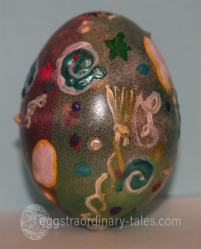 green dyed egg with 3d paint